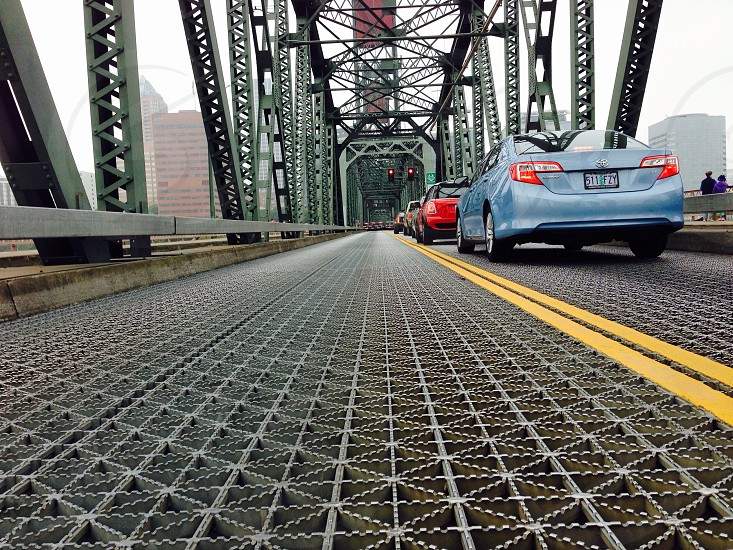 vehicles on metal bridge photo