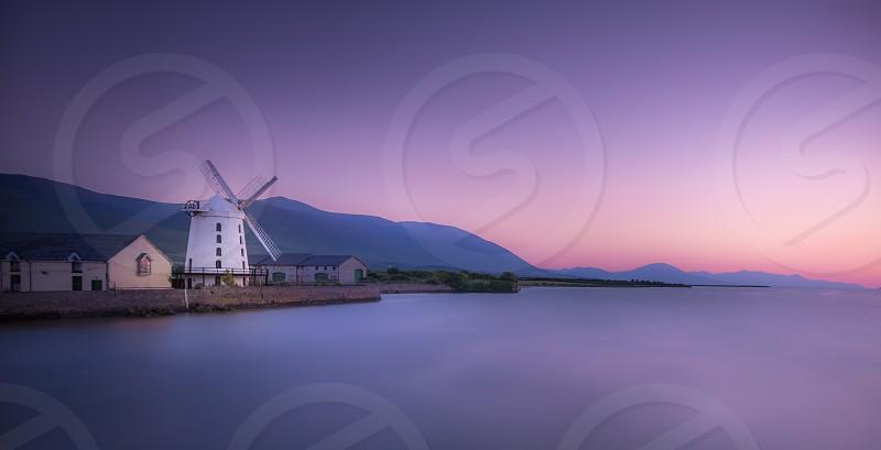 white wind mill near the ocean photo