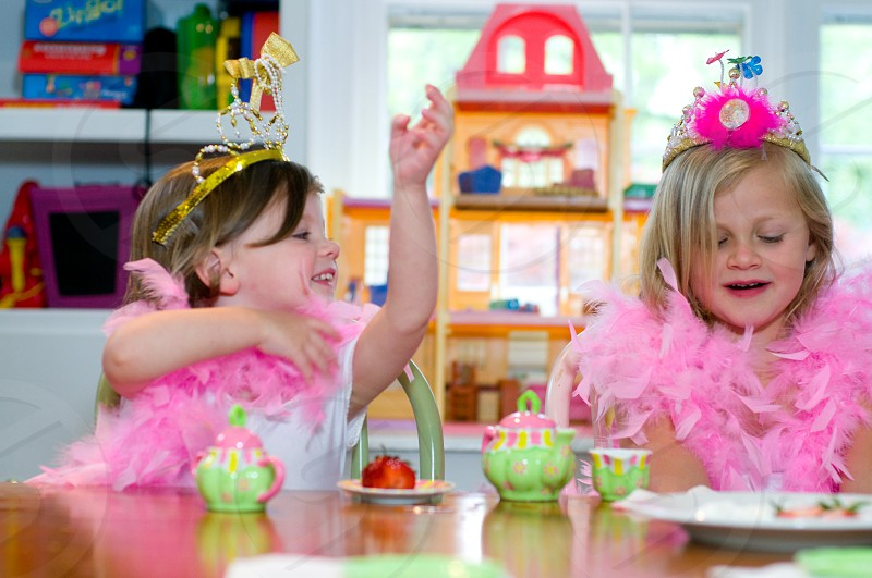 two girls with hats on at a table photo