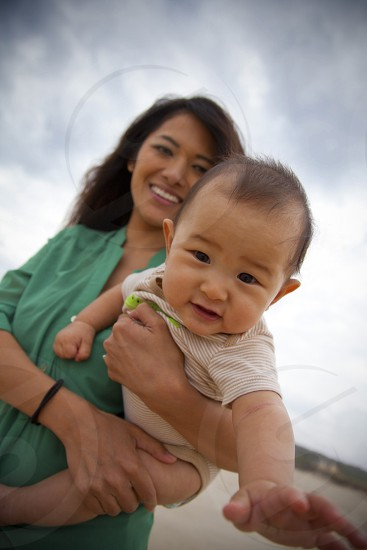 woman carrying a child photo