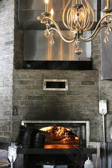 Wood burning stove and chandalier at ARC photo