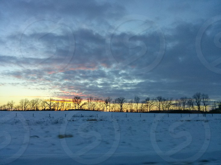 The frozen Wisconsin tundra at sunset. photo