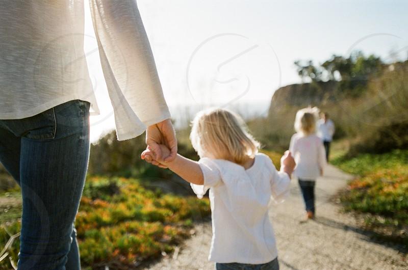 family walking along coast in california photo