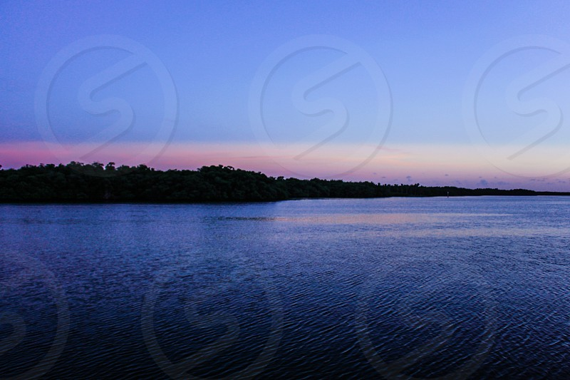 rippling water under blue sky photo