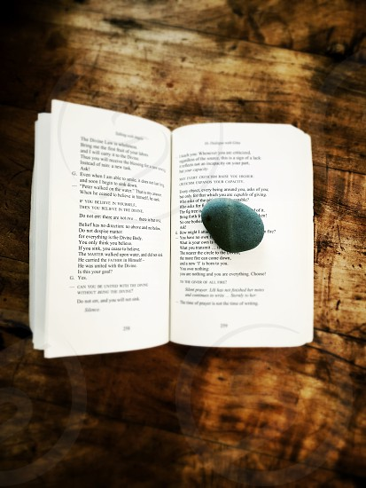 stone on an opened book photo