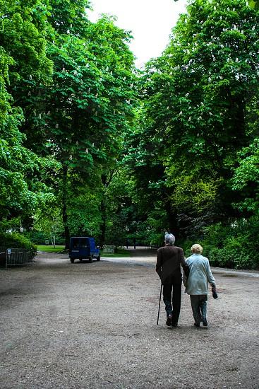 Elderly couple at Luxerbourg Garden in Paris FR photo