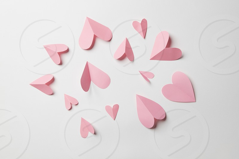 Valentine's day background with hearts on a white photo