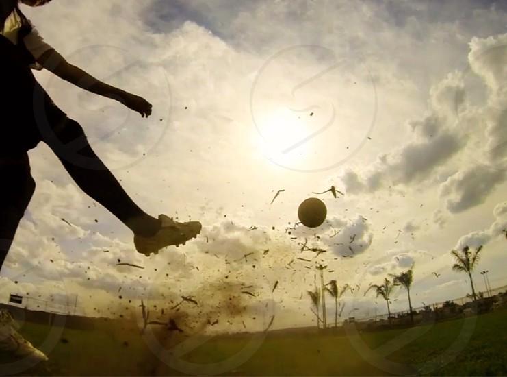 soccer kick into the sky play hard soccer ball sport soccer player early morning  practice kicking ball soccer fun photo