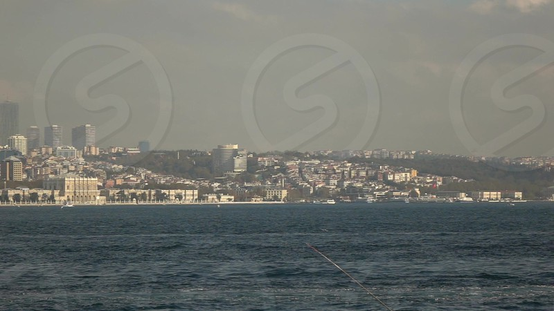 Seascape with beautiful historical side of Istanbul with historical building 15 July Martyrs Bridge and big travel touristic ships. Slow motion Full HD video 240 fps 1080p. photo