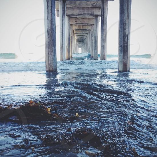 ocean under bridge photo