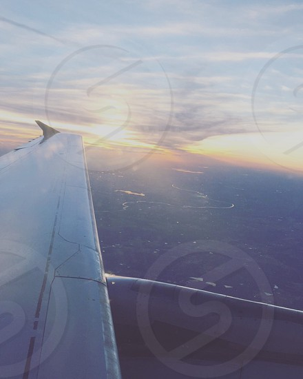 Flying planes up in the air birds eye view sunset beautiful Canada clouds colorful Sky  photo