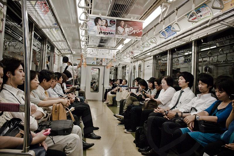 people sitting inside train photo