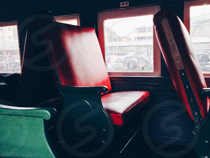 red leather bus seat photo
