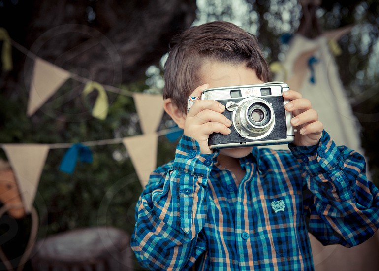 Boy holding Vintage Camera photo