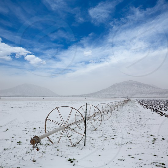Cereal fields with irrigation wheels with snow in Nevada USA photo