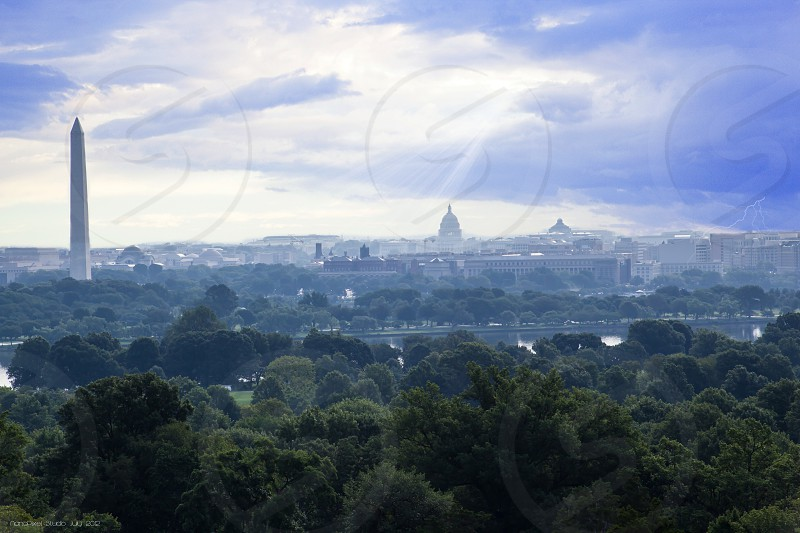 The Washington DC skyline. I created this image to show the turmoil and promises of hope that is going on in DC.  photo