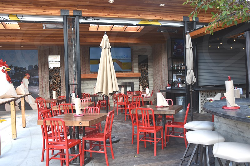 red chairs on brown table near white parasol during daytime photo