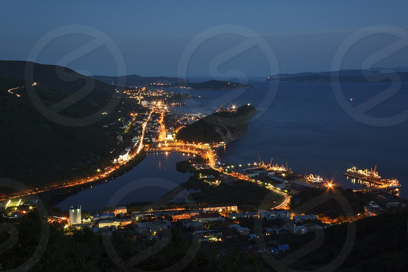 Cityscape: night view of Petropavlovsk-Kamchatsky City Avacha Bay and Pacific Ocean. Kamchatka Peninsula Far East Russia. photo
