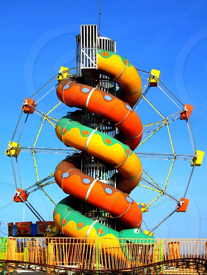 United Kingdom. Lincolnshire. Cleethorpes.  Beach side Helter Skelter in front of a big  wheel. photo