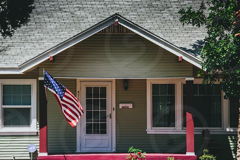 usa flag hanged near house photo