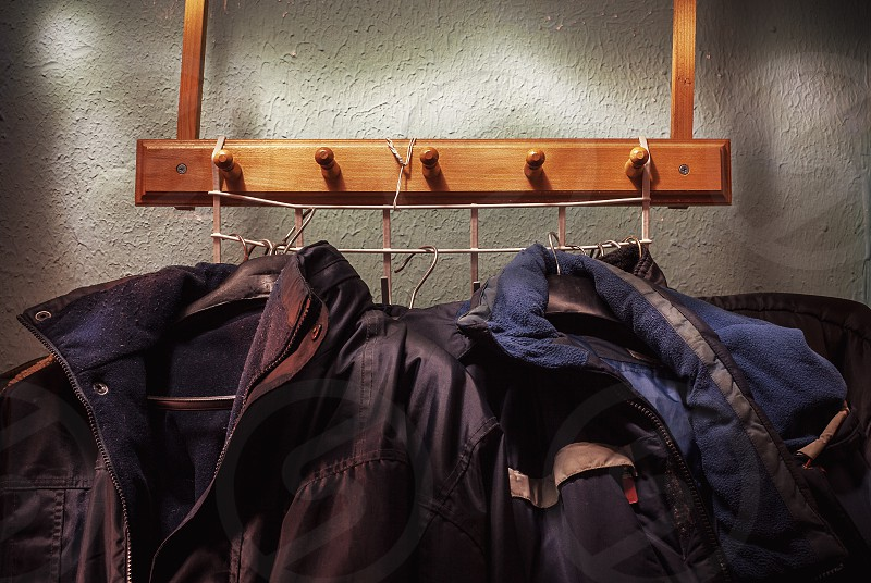Details of hand made hungers for a lot of jackets.  photo