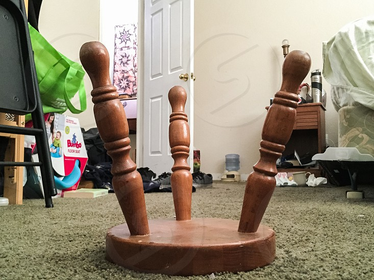 Up side down stool in messy room. photo