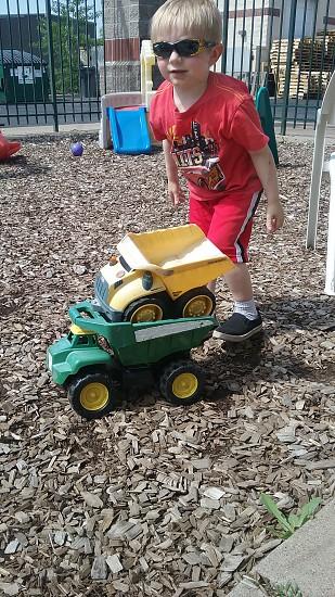 Little boys love their trucks! photo