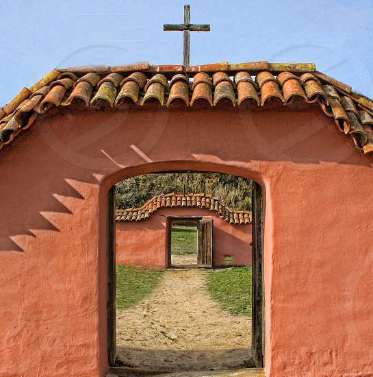 At La Purisima mission the door on an archway frames the one behind it. photo