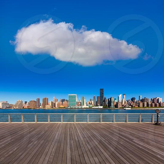 Manhattan New York sunny skyline East River sunshine NYC USA photo