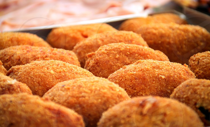 close-up view of a group of fried rice balls (Sicilian arancini) photo