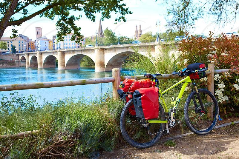 The Way of Saint James biking in Logrono bridge Ebro river at Spain photo