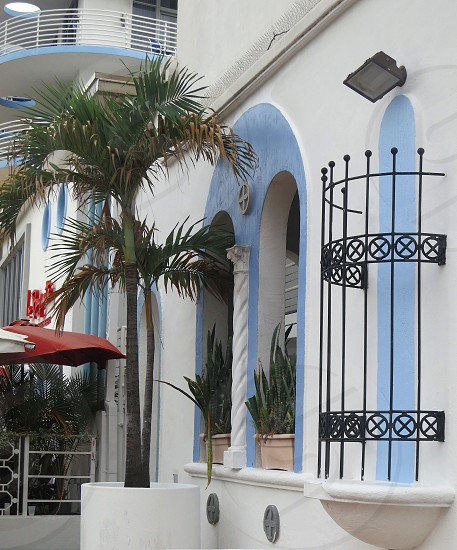 Blue and white art deco building with arches ironwork carved stucco South Beach Miami Florida photo