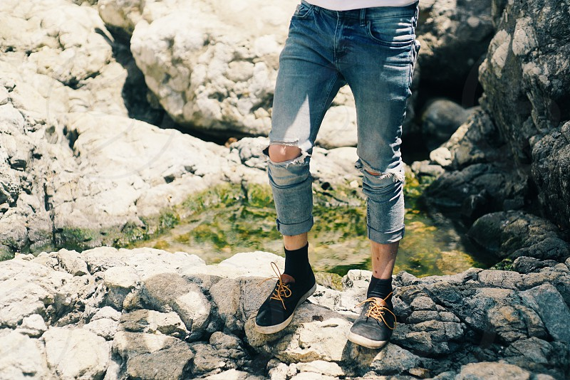 lifestyle; coast; travel; legs; rocks; adventure; jeans; ripped; fun; explore;  photo