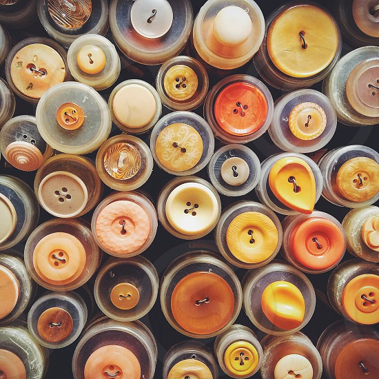 yellow and orange round buttons photo
