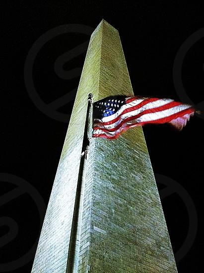 Washington Monument with flag. Washington DC.  photo