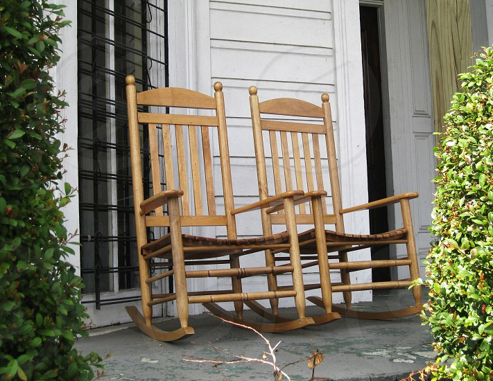 2 brown wooden rocking chairs photo