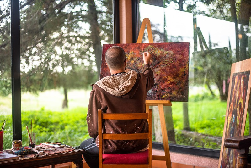 Artist in his studio surrounded by nature photo