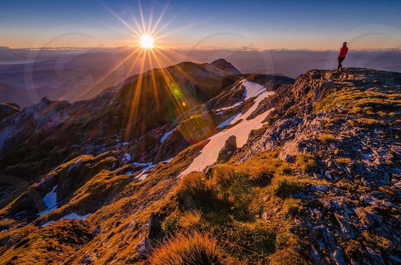 Mount Arthur New Zealand camping summit sunrise sunflare alpine snow nature mountain photo