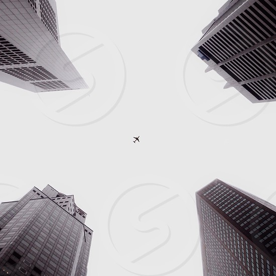 white airplane over the buildings photo