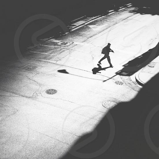 man walking on road way photo