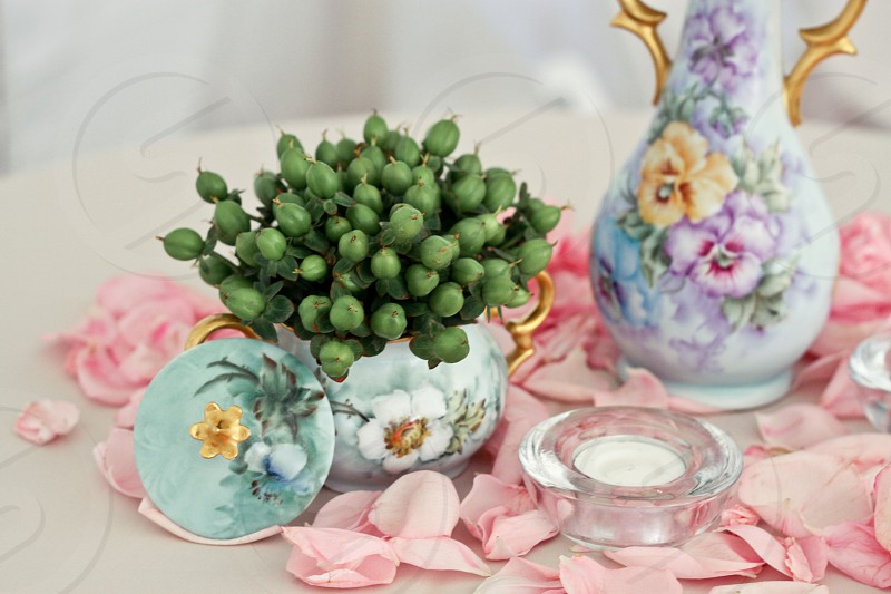 green fruit in blue porcelain vase photo