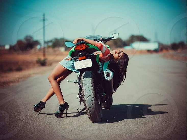 woman leaning on sports bike tilt shift lens photography photo