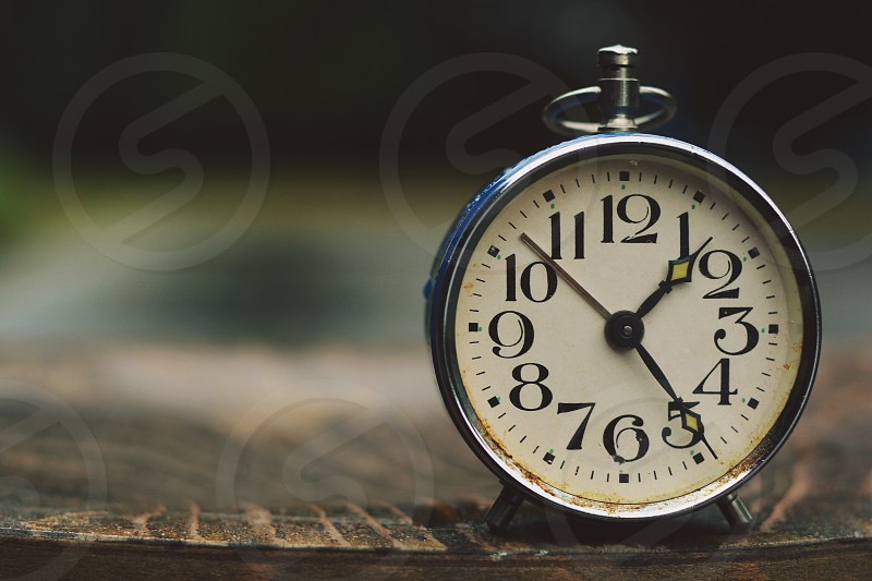Retro alarm clock with retro vintage efect. photo