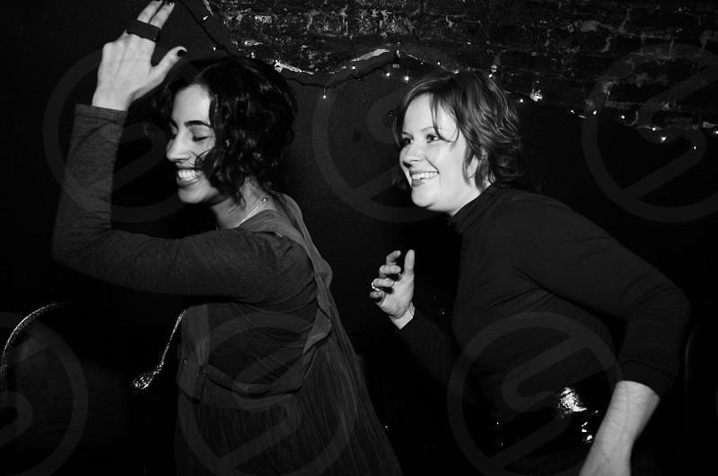 2 women dancing photo