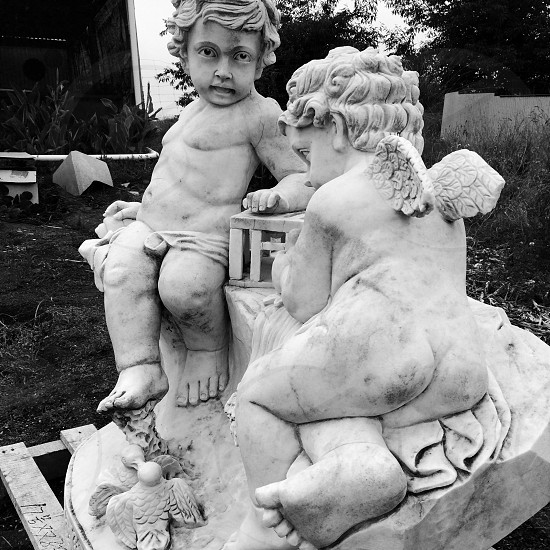 Lounging cherubs photo