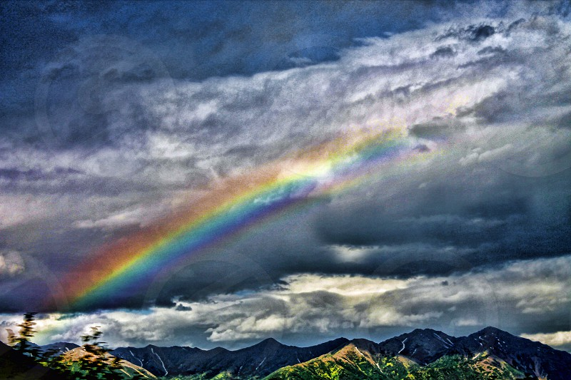Rainbow appears in a stormy sky photo