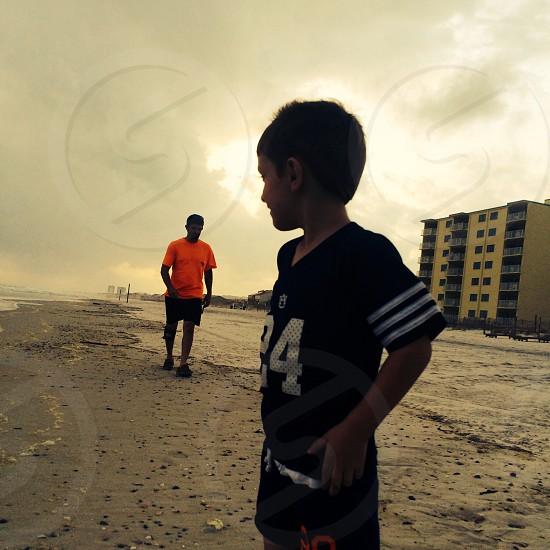 a walk on the beach after a rain storm photo