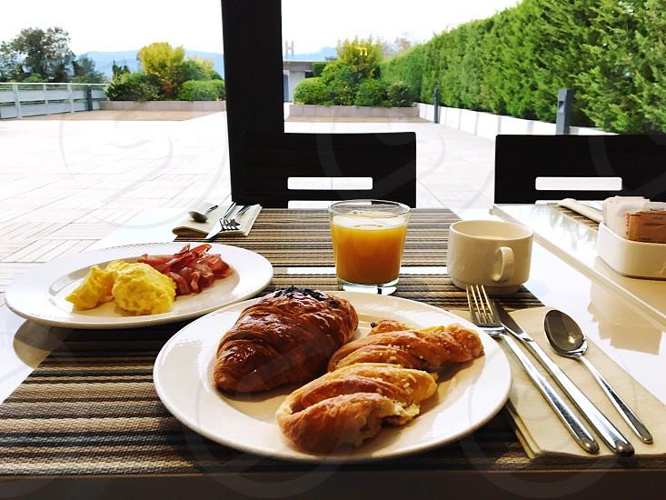food morning patisserie orange juice scrambled eggs bacon photo