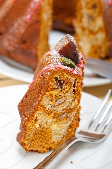 fresh chestnut cake bread dessert with almonds and pistachios on top photo