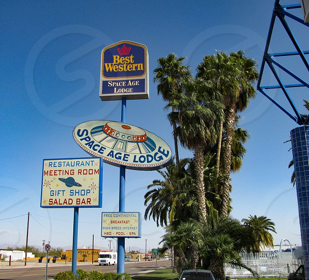 Roadside advertising sign in Gila Bend Arizona for the Space Age Lodge built in 1965 reflects the futuristic and space travel themes of the era with a flying saucer design. photo